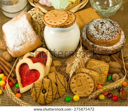 image of different cookies with yogurt and bank closeup