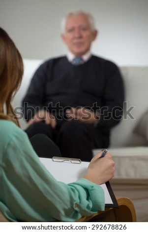 Image of elder man on psychotherapy session - stock photo