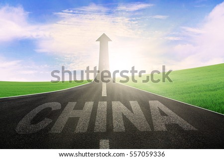 Image of empty asphalt road with word of China and arrow upward at the end of a road