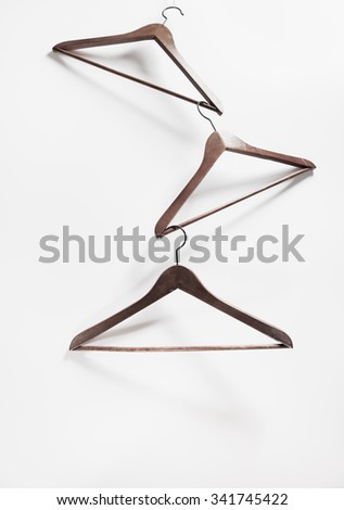 Image of empty hangers on white background. Sale concept - stock photo