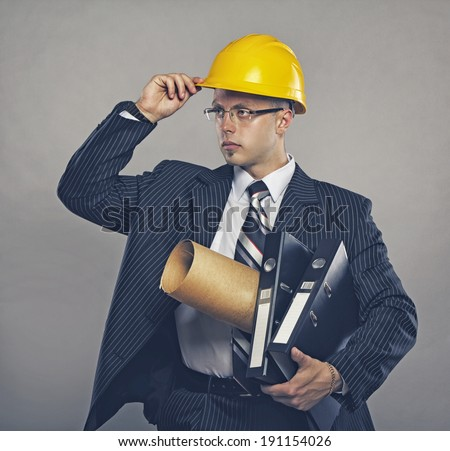 Image of engineer with folders posing in studio - stock photo