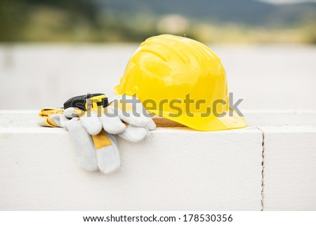 Image of engineer workplace with blueprint, hardhat and measuring tools - stock photo