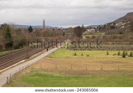 Image of farmland with railway lines running through - stock photo