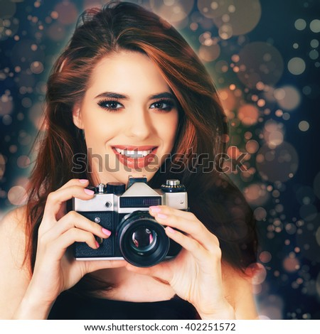 Image of fashion girl make a photo selfie at vintage camera. Take a photography of herself. Funny, party. Beauty. Happy girl smiling. Makeup and hairstyle - stock photo