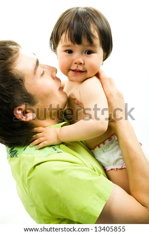 Image of father keeping his adorable little daughter - stock photo