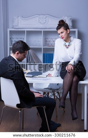 Image of  female boss in workplace and mobbing man