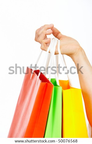 Image of female hand holding multi-colored bags - stock photo