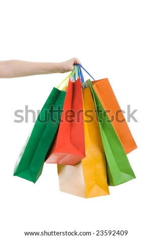 Image of female hand stretching her arm with multi-colored bags - stock photo