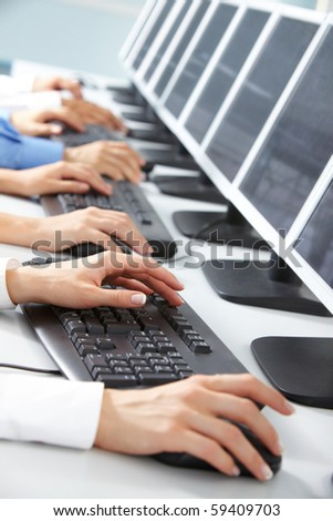 Image of female hand typing in computer classroom - stock photo