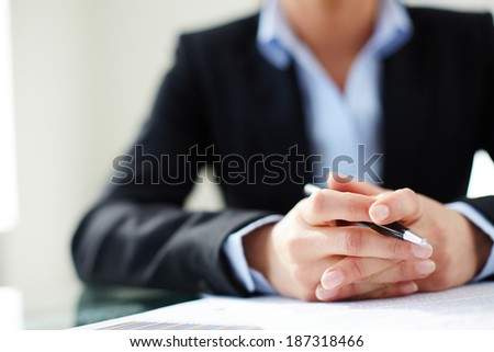 Image of female hands holding pen - stock photo