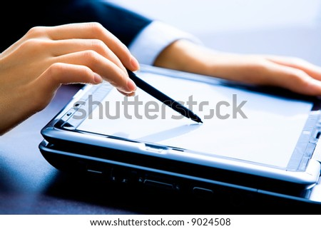 Image of female hands making a demonstration pointing at laptop - stock photo