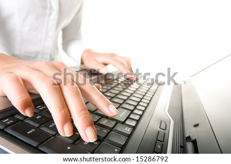 Image of female hands on keyboard of laptop during corporate work - stock photo