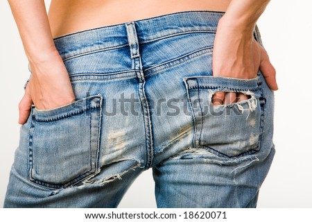 Image of female hands touching beautiful buttocks in jeans