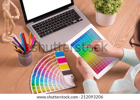 Image of female hands touching screen of digital tablet. Modern designer workplace. Concept of design working office. Modern workplace office - stock photo