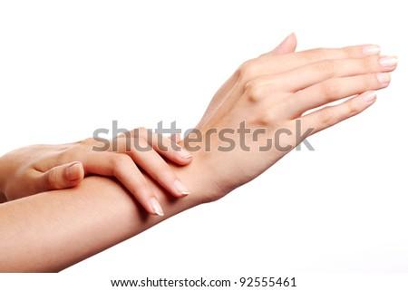 Image of female manicured hands on white background - stock photo
