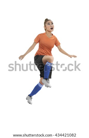 Image of female soccer player header isolated over white background - stock photo