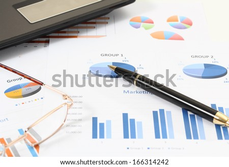 image of financial report for business with pen glasses and notebook computer