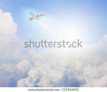 Image of flying airplane in clear sky with sun at background - stock photo