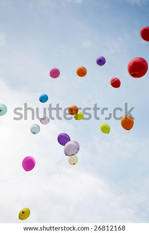 Image of flying balloons of different colors right up into blue sky - stock photo