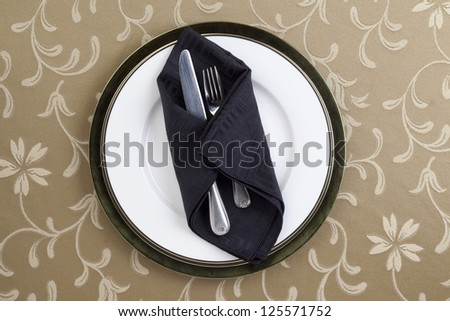 Image of fork and knife with black table napkin - stock photo