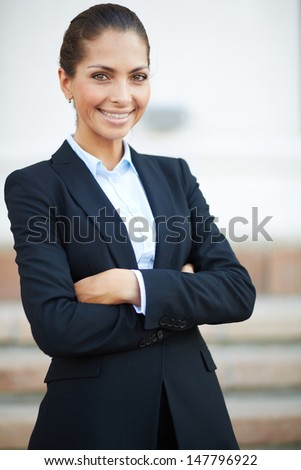 Image of formal businesswoman in suit looking at camera - stock photo