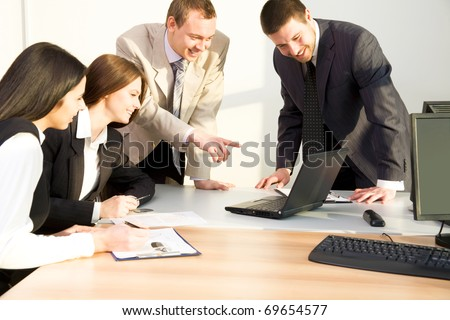 Image of four business people working at meeting - stock photo