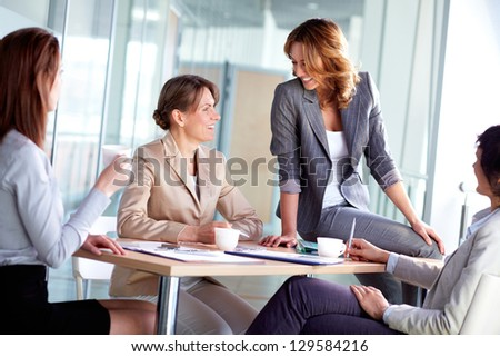 Image of four businesswomen interacting at meeting - stock photo