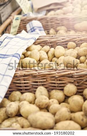 Image of fresh potatoes at local farmers market. - stock photo