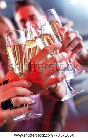 Image of friends hands holding crystal glasses full of champagne - stock photo