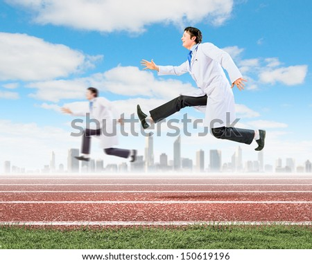 Image of funny doctors running at stadium - stock photo