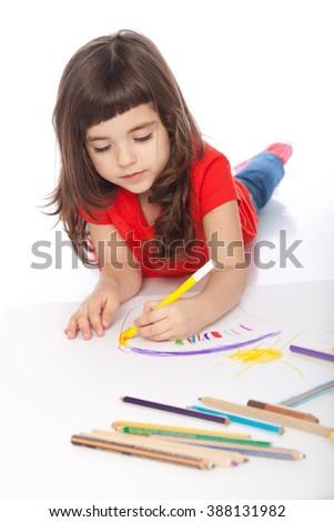 Image of girl doodling, on white background - stock photo
