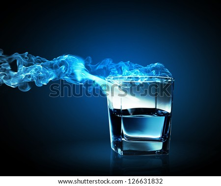 Image of glass of blue cocktail with fume going out - stock photo