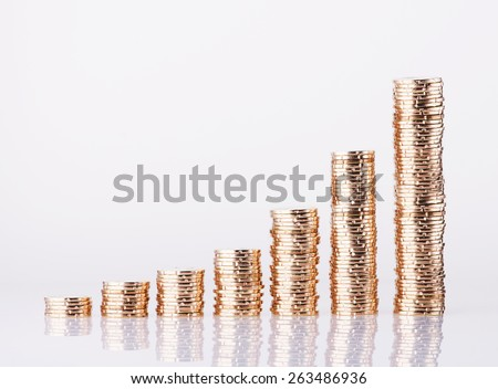 Image of Golden coins stack on over white background - stock photo