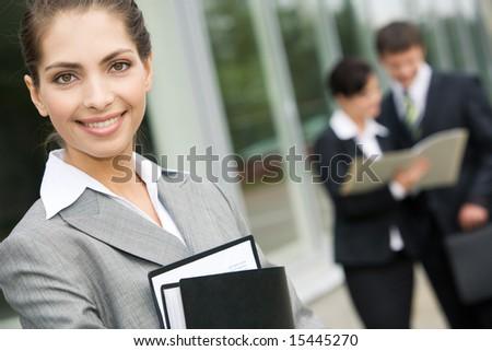 Image of good-looking businesswoman in grey suit outdoor - stock photo