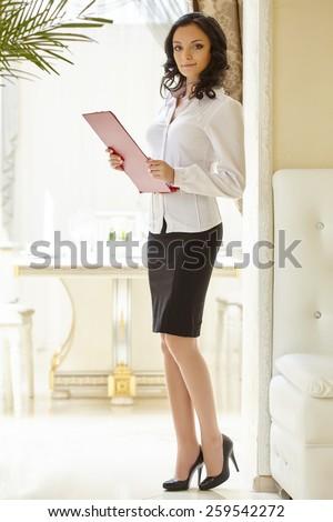 Image of good-looking hostess at restaurant - stock photo