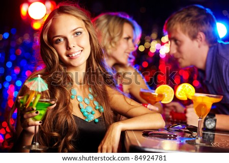 Image of gorgeous girl with cocktail looking at camera