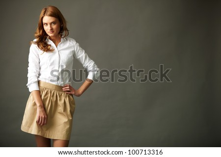 Image of gorgeous woman in smart casual looking at camera - stock photo