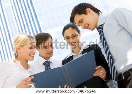 Image of group of several workers planning their work outside - stock photo