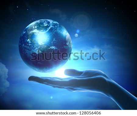 Image of hand holding earth planet against illustration background.Elements of this image are furnished by NASA - stock photo