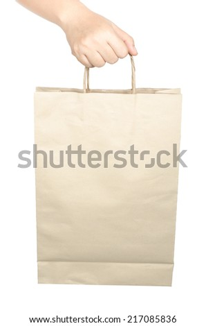 Image of hand holding paper bag isolate on white background - stock photo