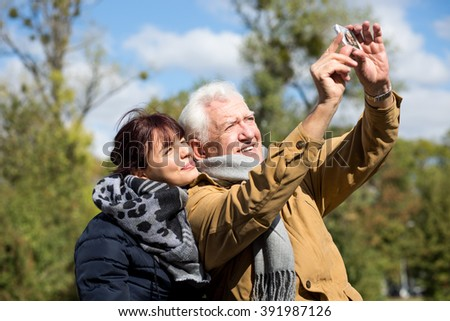 Image of handicapped male taking selfie with daughter - stock photo