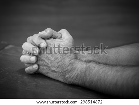 image of hands of a man praying to God, Black and white - stock photo