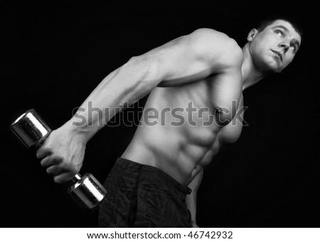 Image of handsome athlete in the dark. - stock photo