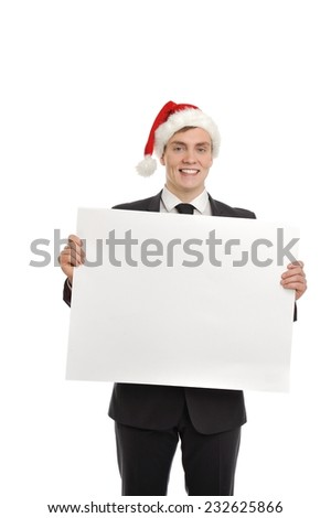 Image of handsome business man in Santa cap holding blank message. Sale, buying, Xmas gifts, presents etc. concept. Isolated on white background. - stock photo