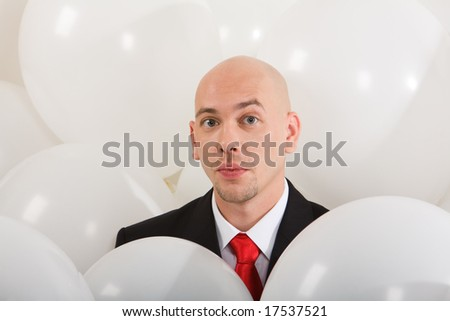 Image of handsome businessman inside white balloons - stock photo