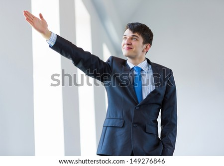 Image of handsome confident businessman in business suit