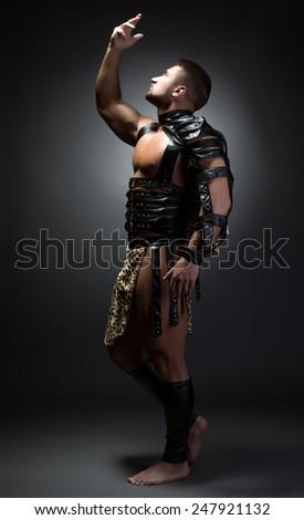 Image of handsome dancer posing as primitive man - stock photo