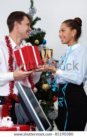 Image of happy businesswoman making present to ceo at corporate party - stock photo