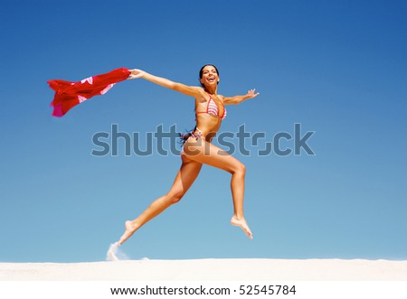 Image of happy girl running down sandy beach in summer - stock photo