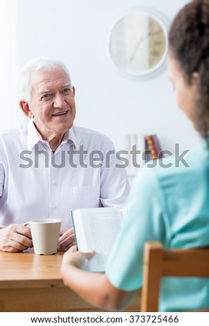 Image of happy old man having professional home care - stock photo